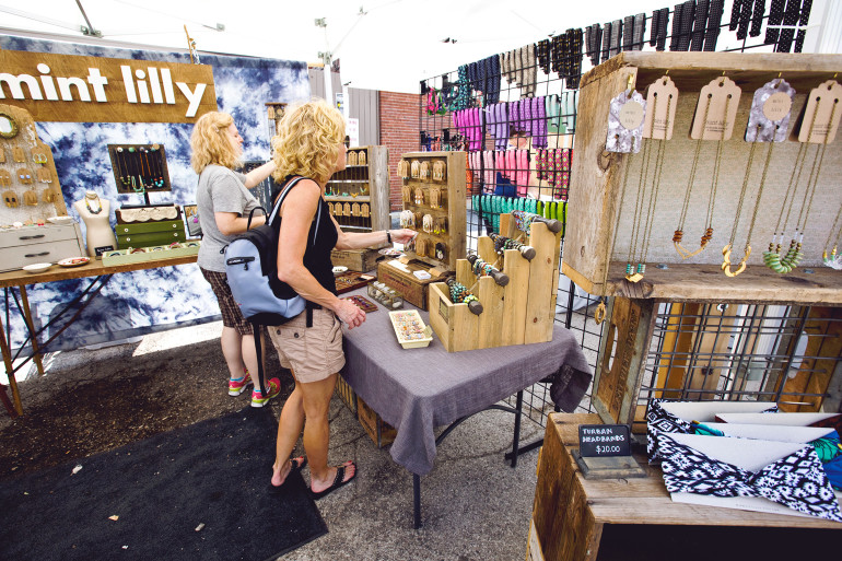 Customers shopping at the Mint Lilly booth. (image by Haley Neale of Little Robot Photography © 2015)
